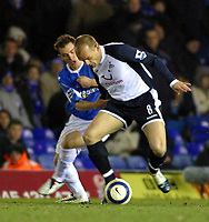 Photo: Dave Linney.<br />Birmingham City v Tottenham Hotspur. The Barclays Premiership. 18/03/2006Spurs .Danny Murphy(R) holds of the challenge from Martin Taylor