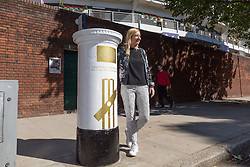 ECB Head of Communications Claire Jackson poses with a white-painted postbox outside Lords Cricket Ground with a plaque and graphics that celebrate England's ICC Cricket World Cup Victory. London, July 16 2019.