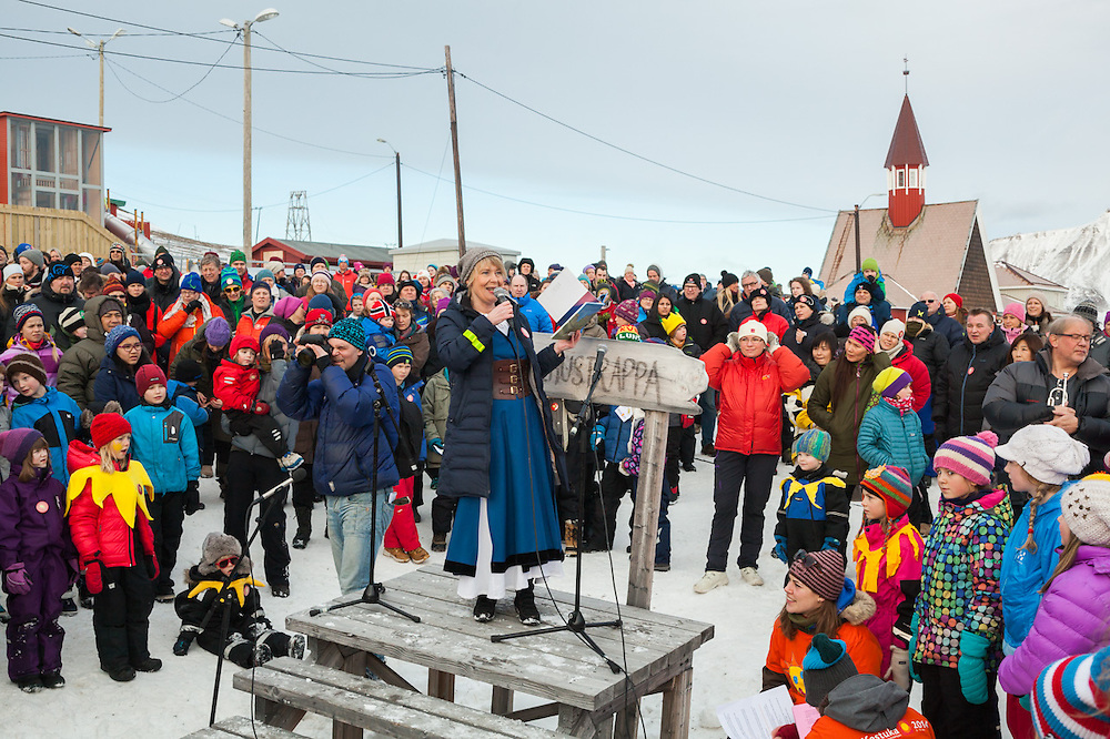 Librarian Elin Anita Olsrud reads a story about the sun's many missed appearances during past celebrations at SolFest in Longyearbyen, Svalbard. The festival marks the official arrival of the sun to the town – by tradition, to the old hospital steps (sykehustrappa).
