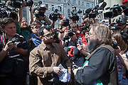 Moscow, Russia, 27/05/2012..A gay activist and a Russian nationalist confront one another in a media scrum during clashes as Russian nationalists attacked gay rights activists during their seventh attempt to hold a gay pride parade in the Russian capital.