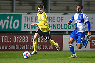 Jonny Smith of Burton Albion (11) and Josh Grant of Bristol Rovers (4) battle for the ball during the EFL Sky Bet League 1 match between Burton Albion and Bristol Rovers at the Pirelli Stadium, Burton upon Trent, England on 2 March 2021.