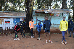 © Licensed to London News Pictures. 02/02/2014. Iten, Kenya. Running in Africa feature. Runners stretch after a run. Photo credit : Mike King/LNP