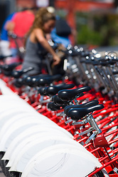 Row bicycles hire red white bike cycle rental