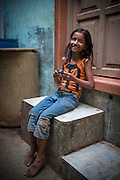 Young Girl on Step - Dharavi, Mumba, India