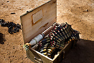 A box of looted bullets from an army barracks and a land mine.
