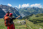 """Walk downhill from Eigergletscher train station (of the Jungfraujoch """"Top of Europe"""" railway) under the north face of the Eiger (3970m / 13,020 ft elevation) to Alpiglen station in Grindelwald Valley, Canton of Bern, Switzerland, the Alps, Europe. The Eiger has the biggest north face in the Alps: 1800 vertical meters (or 5900 ft) of rock and ice. The Swiss Alps Jungfrau-Aletsch region is honored as a UNESCO World Heritage Site.The Swiss Alps Jungfrau-Aletsch region is honored as a UNESCO World Heritage Site. For licensing options, please inquire."""