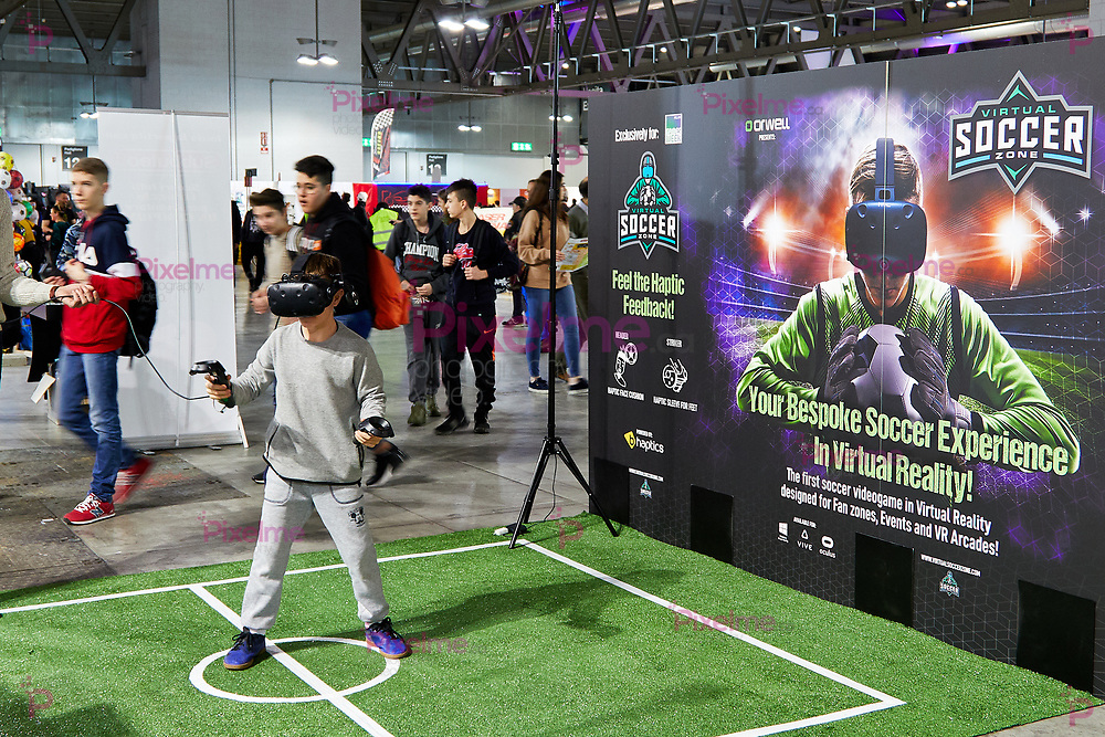 Milan, Italy - March 8 2019 Cartoomics Comic Con a kid plays soccer with Virtual Reality Technology