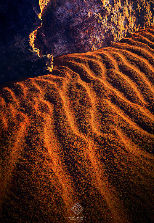 During an exploring trip to the wilds of northern Saudi Arabia, the reflected light on the sand is attracted me here with these small details.