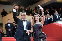 Angelina Jolie and Brad Pitt were married Saturday in the French hamlet of Correns, a spokesman for the couple says. Jolie and Pitt wed in a small chapel in a private ceremony attended by family and friends at Provence's Chateau Miraval. In advance of the nondenominational civil ceremony, Pitt and Jolie obtained a marriage license from a local California judge. The judge also conducted the ceremony in France. File photo : U.S. actor Brad Pitt and wife Angelina Jolie arrive for the screening of 'Tree of Life' at 64th Cannes Film Festival, in Cannes, France, on May 16, 2011. Photo by Ammar Abd Rabbo/ABACAPRESS.COM