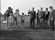 Charles Haughey Visits The Community Games. (T5)..1989..03.10.1989..10.03.1989..3rd September 1989..An Taoiseach, Charles Haughey TD,accompanied by Mr Frank Fahey, TD, Minister of State with responsibility for Youth and Sport attended the Twentieth National Finals of the Community Games at Mosney,  Co.Meath yesterday...An Taoiseach is pictured taking over the starting responsibilities as he gets this junior race underway.