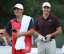 September 20, 2018 - Atlanta, GA, USA - Rory McIlroy and his caddie Harry Diamond share a laugh following his birdie on the third hole as he prepares to tee off on the fourth hole on his way to another birdie during the first round of the Tour Championship at East Lake Golf Club on Thursday, Sept. 20, 2018, in Atlanta, Ga. McIlroy made birdies on the second, third, and fourth holes to get off to a fast start. (Credit Image: © Curtis Compton/Atlanta Journal-Constitution/TNS via ZUMA Wire)