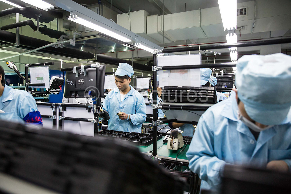 Employees and Smartphones seen on the assembly line at the OnePlus manufacturing facility in Dongguan, China, on Thursday, Dec. 17, 2015. OnePlus is part of a crop of upstart Chinese companies that are intensifying competition throughout the industry and crushing profit at established giants such as HTC Corp. and Samsung Electronics Co.