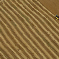 Aerial view of a farmer near Auchterarder, Perthshire at work on his fields in a combine harvester.<br /> Picture by Graeme Hart.<br /> Copyright Perthshire Picture Agency