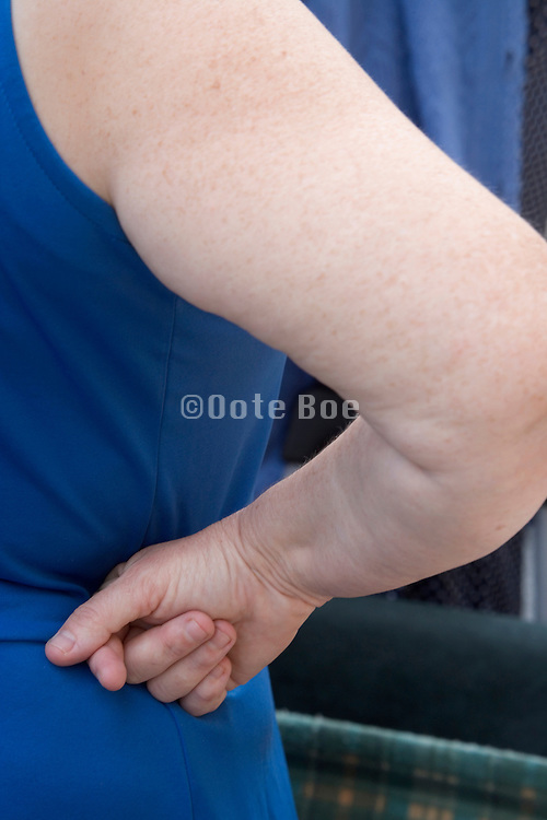 woman who has planted her hands in her sides