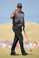 Golf - 2013 Open Championship at Muirfield - Friday Round Two<br /> Lee Westwood of England acknowledges the crowds applause following his putt on the 5th