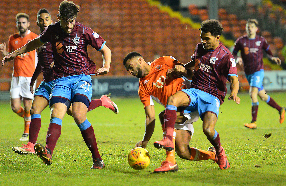 Blackpool's Curtis Tilt is challenged in the penalty box by Scunthorpe United's Duane Holmes<br /> <br /> Photographer Richard Martin-Roberts/CameraSport<br /> <br /> The EFL Sky Bet League One - Blackpool v Scunthorpe United - Tuesday 26th December 2017 - Bloomfield Road - Blackpool<br /> <br /> World Copyright © 2017 CameraSport. All rights reserved. 43 Linden Ave. Countesthorpe. Leicester. England. LE8 5PG - Tel: +44 (0) 116 277 4147 - admin@camerasport.com - www.camerasport.com