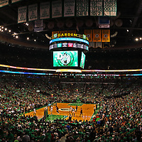 This Boston sport panorama photography image of the Boston Celtics at the TD Garden is available as museum quality photography prints, canvas prints, acrylic prints, wood prints or metal prints. Wall art prints may be framed and matted to the individual liking and decorating needs:<br /> <br /> https://juergen-roth.pixels.com/featured/lets-go-celtics-juergen-roth.html<br /> <br /> Boston Celtics playing Washington Wizards in the NBA basketball eastern conference semi final game 7 at the TD Garden in Boston. The C's are an American professional basketball franchise based in Boston, Massachusetts. They play in the Atlantic Division of the Eastern Conference in the National Basketball Association and the C-Green Smash Machine holds 17 NBA titles: 2008, 1986, 1984, 1981, 1976, 1974, 1969, 1968, 1966, 1965, 1964, 1963, 1962, 1961, 1960, 1959, 1957.<br /> <br /> Good light and happy photo making!<br /> <br /> My best,<br /> <br /> Juergen<br /> Image Licensing: http://www.RothGalleries.com <br /> Fine Art Prints: http://juergen-roth.pixels.com<br /> Photo Blog: http://whereintheworldisjuergen.blogspot.com<br /> Twitter: https://twitter.com/naturefineart<br /> Facebook: https://www.facebook.com/naturefineart <br /> Instagram: https://www.instagram.com/rothgalleries