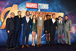 Left to right, Joe Russo, Sebastian Stan, Tom Hiddleston, Elizabeth Olsen, Paul Bettany, Letitia Wright, Benedict Cumberbatch, Tom Holland and Anthony Russo attending the Avengers: Infinity War UK Fan Event held at Television Studios in White City, London.