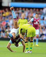 Rudy Gestede of Aston Villa (l) tumbles over Will Vaulks of Rotherham Utd.EFL Skybet championship match, Aston Villa v Rotherham Utd at Villa Park in Birmingham, The Midlands on Saturday 13th August 2016.<br /> pic by Andrew Orchard, Andrew Orchard sports photography.