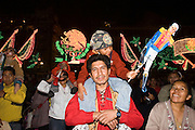 "15 SEPTEMBER 2005 - MEXICO CITY: Revelers on the Zocalo in Mexico City, Sept 15, hold up a cardboard puppet of Mexican national hero Benito Juarez during the traditional ""grito,"" the shout of ""Viva Mexico"" that marks the official start of Mexican Independence Day celebrations. Although Mexican Independence Day is Sept. 16, the celebrations usually start a couple of days before and continue through the 17th or 18th or September. It is the most important holiday on the Mexican calender. PHOTO BY JACK KURTZ"
