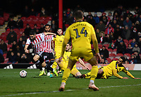 Football - 2018 / 2019 FA Cup - Third Round: Brentford vs. Oxford United<br /> <br /> Brentford's Neal Maupay is fouled by Oxford United's Curtis Nelson and John Mousinho leading to the penalty, at Griffin Park.<br /> <br /> COLORSPORT/ASHLEY WESTERN