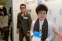 Fashion designer Ms Octo Cheung (R) receives her 40 Under 40 Perspective magazine award.