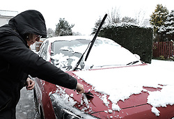 West Lothian Weather, Wednesday 3rd April 2019<br /> <br /> Pictured: A woman clears snow from her car<br /> <br /> Alex Todd | Edinburgh Elite media