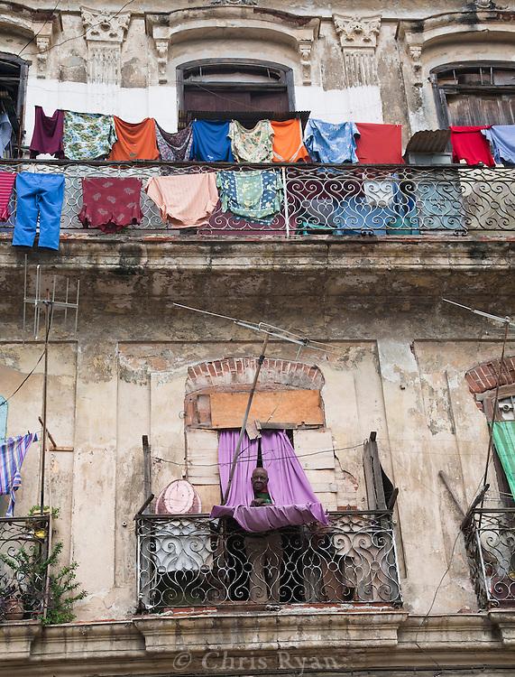 Man on balcony, Havana, Cuba