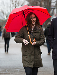 © Licensed to London News Pictures. 27/01/2016. London, UK. A woman walks with an umbrella  in central London during wet and windy weather. Storm Jonas continues to bring rain and gales to the UK today.  Photo credit : Vickie Flores/LNP