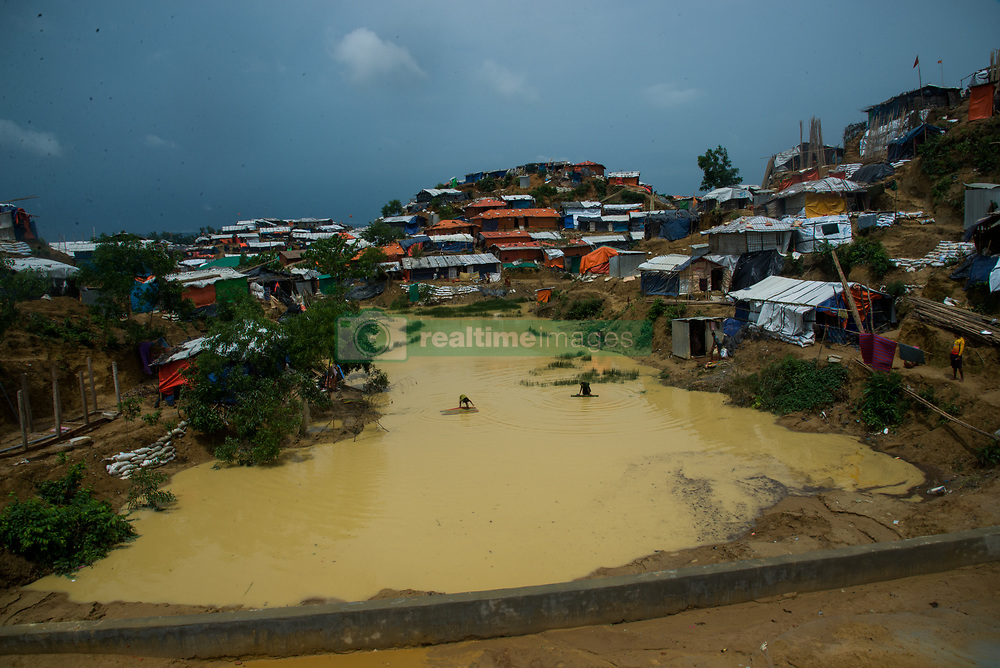 June 15, 2018 - Cox'S Bazar, Bangladesh - As the hundreds of thousand rohingya fled from myanmar violence and taken shelter on the hills of Cox's Bazar (southern part of Bangladesh) on 16 June 2018. They started cutting trees on the hills for their livelihood even hills have been removed by cutting down for their living place. As the Rohingya families are living inside the tents on the hills, landslides are killing rohingya lives as caused by heavy rains and storms. (Credit Image: © Masfiqur Sohan/NurPhoto via ZUMA Press)