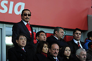 Cardiff city owner Vincent Tan, flanked by a security guard looks on ahead of k/o.  Barclays Premier league, Cardiff city v Southampton at the Cardiff city Stadium in Cardiff,  South Wales on Boxing day, Thursday 26th Dec 2013. <br /> pic by Andrew Orchard, Andrew Orchard sports photography.