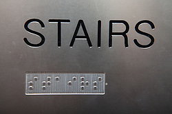 Stairs sign; also shown in Braille signage,