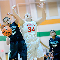 Thoreau Hawk Vernisha Marshall (11), left, and Valencia Jaguar Hailee Brown (34) vie for a rebound during the Wingate Holiday Classic girls basketball tournament at Wingate High School Friday.