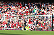Arsenal midfielder Aaron Ramsey (8) - out of picture - scores a goal to make it 2-1 during the Premier League match between Arsenal and West Ham United at the Emirates Stadium, London, England on 22 April 2018. Picture by Bennett Dean.