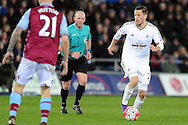 Swansea City's Gylfi Sigurdsson in action. Barclays Premier league match, Swansea city v Aston Villa at the Liberty Stadium in Swansea, South Wales on Saturday 19th March 2016.<br /> pic by  Carl Robertson, Andrew Orchard sports photography.