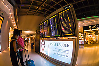 Travelers checking departure schedule, Suvarnabhumi International Airport, Bangkok, Thailand
