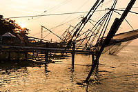 The Chinese fishing nets at  Kochi are used for a unique method of fishing. Operated from shore the nets are extended on bamboo poles and held up by huge mechanical strctures which are lowered and raised from the sea. They are counter weighed by large stones.  Each net is operated by a team of some five or six fishermen.  The net is left in the water for only a short time; just a few minutes before it is raised back up by tugging ropes. The Chinese Fishing Nets of Cochin are said to have their origin in China.