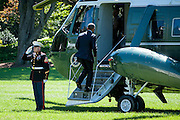 """President Barack Obama boards Marine One on the South Lawn of the White House as he travels to join Education Secretary Arne Duncan for his sixth annual """"Back-to-School bus tour,"""" in Des Moines, Iowa U.S., on Monday, Sept. 14, 2015.  Obama and Duncan will host a town hall at North High School to discuss college access and affordability as well as changes to the college financial aid system to allow more flexible deadlines. Photo: Pete Marovich/Bloobmerg/Pool"""