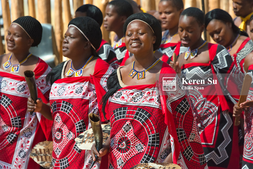 Swazi girls in traditional clothing dancing, Mantenga Cultural Village, Swaziland