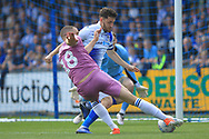 Aaron Wilbraham's shoots during the EFL Sky Bet League 1 match between Bristol Rovers and Rochdale at the Memorial Stadium, Bristol, England on 22 April 2019.