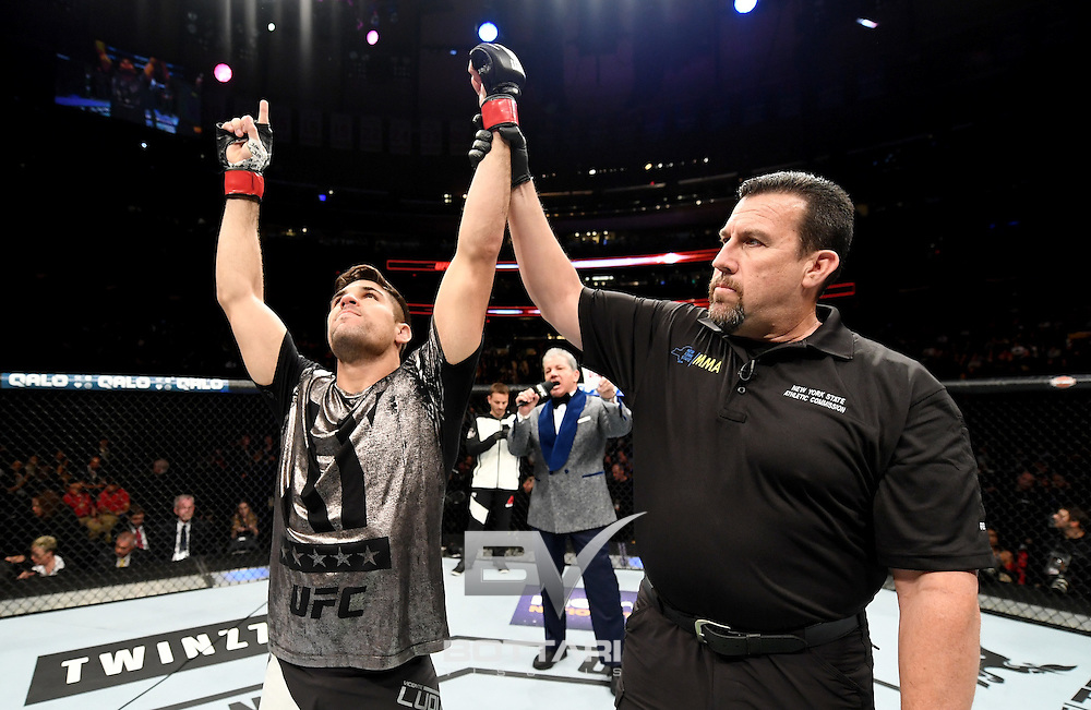 NEW YORK, NY - NOVEMBER 12:  Vicente Luque of Brazil celebrates his win by TKO over Belal Muhammad of the United States in their welterweight bout during the UFC 205 event at Madison Square Garden on November 12, 2016 in New York City.  (Photo by Jeff Bottari/Zuffa LLC/Zuffa LLC via Getty Images)