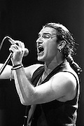 Bono performs in the late 1980's at Wembley Stadium, London, UK.