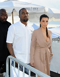 File photo dated May 23, 2012 of Kim Kardashian and Kanye West leaving the Nikki Beach in Cannes, France. US rapper Kanye West took to Twitter over the weekend to announce he was running for president, with his declaration quickly going viral and prompting a flurry of speculation. His wife Kim Kardashian West and entrepreneur Elon Musk endorsed him. Photo by Favier/ABACAPRESS.COM
