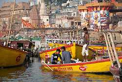 May 18, 2019 - Varanasi, India - On 18 May 2018, young Indian men sit on a row boat on the Ganges River, which is considered to be holy and pure in the Hindu religion. Photo taken in the city of Varanasi, India. (Credit Image: © Diego Cupolo/NurPhoto via ZUMA Press)