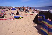 AYBRC6 Walberswick beach crowded in summer Suffolk England