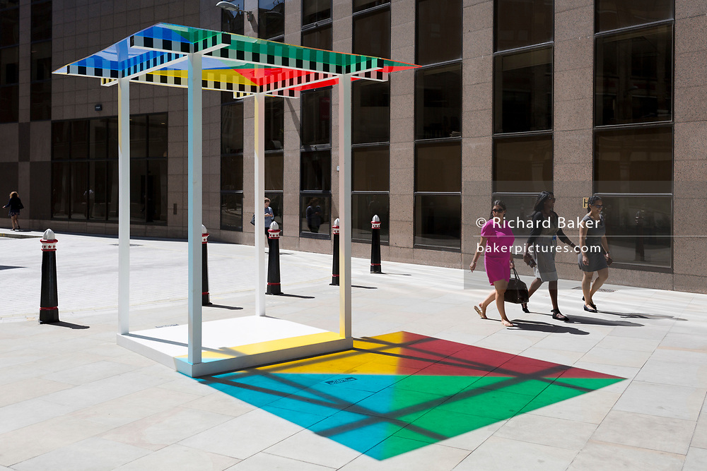 "Art in the City artwork entitled ""4 Colours at 3 Meter High"" by Daniel Buren leaves multi-coloured patterns from strong sunlight  on the pavement at One Creechurch Place, on 17th Juy 2017, in the City of London, England."