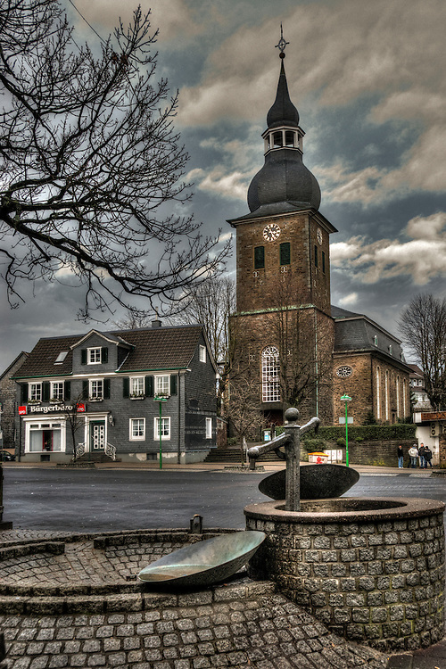 Churh and well in Radevormwald town square