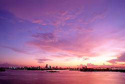 Flagler Memorial Island, downtown Miami and Biscayne Bay at sunset, view from Miami Beach, Florida