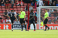 Football - 2021/ 2022 Premier League - Southampton vs. West Ham United - St Mary's Stadium - Saturday 11th August<br /> <br /> Aaron Cresswell of West Ham United complains to Referee Mr David Coote about a high boot as the sides leave the pitch for half time at St Mary's Stadium Southampton<br /> <br /> COLORSPORT/Shaun Boggust