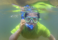 Exploring the beach underwater at Ellacoya State Park.  (Karen Bobotas Photographer)